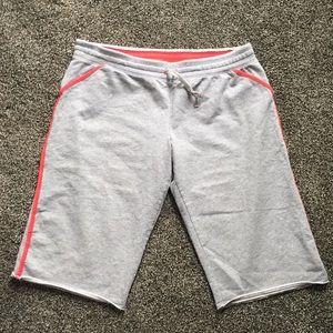 Women's NIKE grey and salmon long sweat shorts. LG